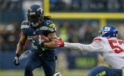 Marshawn Lynch had a huge week against the Giants, rushing for four touchdowns (Via Getty)